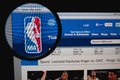 Nba photo of homepage on a monitor screen through a magnifying glass Royalty Free Stock Photography