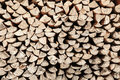 Neat stack of cut wood, textured background Royalty Free Stock Photo