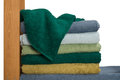 A neat stack of terry towels on a rack isolated white background Royalty Free Stock Photo