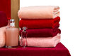 A neat stack of terry towels on a rack isolated white background Stock Image