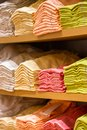 Neat stacks of folded clothing on the shop shelves Stock Images
