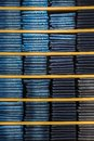Neat stacks of folded jeans on the shop shelves Royalty Free Stock Photography
