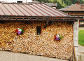 Neat wood stack with flowers for winter burning stacked up neatly at the side of a house in a northern italian village small gaps Stock Photography