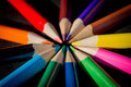 Neatly arranged pencils on black photo of color Royalty Free Stock Photos