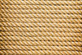 Neatly organised parallel strands of rope a thick new natural fiber arranged horizontally in a full frame texture background Stock Images