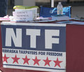 Nebraska taxpayers for freedom booth with louises memorial fund container fair federation american immigration reform held a Royalty Free Stock Photos
