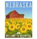 Nebraska travel poster. Sunflowers in front of old red barn.
