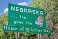 Nebraska welcome road sign the good life home of arbor day roadside at state border Stock Photo