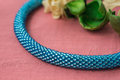 Necklace fragment from beads of turquoise color close up Stock Image