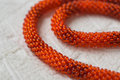 Necklace fragment from bright orange beads close up Royalty Free Stock Images