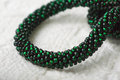 Necklace fragment from green beads close up Stock Photos