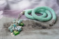 Necklace of mint color on a textile background close up Royalty Free Stock Image