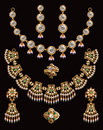 Necklace sets indian gold isolate on black Stock Images