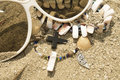 Necklace, shell, beads and cross on the sand Royalty Free Stock Image