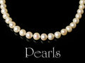 Necklace of white pearls isolated on black Royalty Free Stock Images