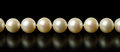 Necklace of white pearls isolated on black Royalty Free Stock Image