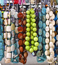 Necklaces at a market Stock Images