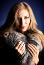 Neckpiece portrait of a beautiful woman in a jacket with fur Royalty Free Stock Images