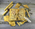 Necronomicon book with magic objects halloween still life voodoo doll and on the table Royalty Free Stock Images