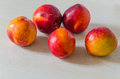 Nectarine close up of a collection of red on the wood table Stock Photo