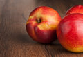 Nectarine fruits on wooden table Stock Image