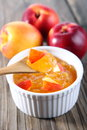 Nectarine peach jam on wood background Stock Photography