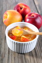 Nectarine peach jam on wood background Stock Photos
