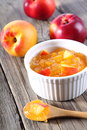 Nectarine peach jam on wood background Royalty Free Stock Photos