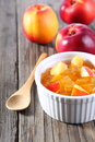 Nectarine peach jam on wood background Stock Image