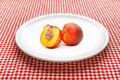 Nectarine on plate sweet fruit white served kitchen table Royalty Free Stock Image