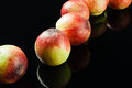 Nectarines fresh on black background Stock Images