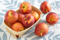Nectarines fresh ripe in a basket Stock Photos
