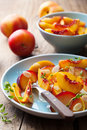 Nectarines and plums in syrup Stock Images