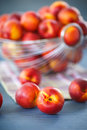 Nectarines ripe sweet on wooden table close up Stock Images