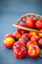 Nectarines ripe sweet on wooden table close up Royalty Free Stock Image