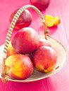 Nectarines in a vintage bowl Stock Images