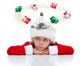 Need a christmas gift idea little girl in for present with lightbulbs in her santa hat Stock Photography