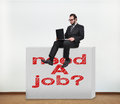 Need a job businessman sitting on concrete wall with drawing Royalty Free Stock Image