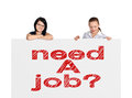 Need a job two women and placard with drawing Royalty Free Stock Photo