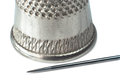 Needle and thimble in macro isolated on white background psd Royalty Free Stock Images