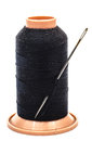 Needle and thread black spool of with a for sewing Royalty Free Stock Images
