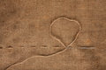 Needle and thread on burlap background Stock Images
