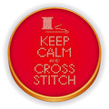 Needle and thread embroidery on wood hoop retro with needlework sewing design keep calm cross stitch sampler spool of isolated Stock Photography