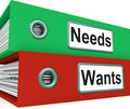Needs wants folders show requirement and desire showing Stock Image