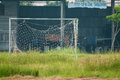 Neglected empty soccer football net on field , unused, dilapidated , Old goal Royalty Free Stock Photo