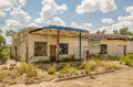 Neglected service station automotive repair shop and gas tried selling auto parts before it was abandoned on route Royalty Free Stock Photo