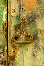 Neglected wooden door with peeling paint and rusty handle Stock Photography
