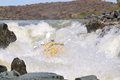 Negotiating hell s gate in the gariep river orange river sout white water rafting an inflatable raft going down Royalty Free Stock Image