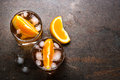 Negroni cocktail in glass on dark. Royalty Free Stock Photo