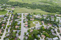 Neighborhood aerial an image of a small town with a green space and park behind Stock Images
